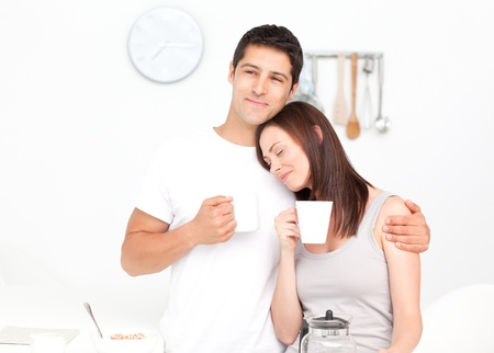 Lovely couple drinking coffee during breakfast photo