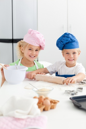 Cute sibling baking cookies together in the kicthen Stock Photo - 10215246