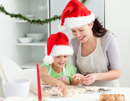 Lovely mother and daughter preparing Christmas cookies  photo