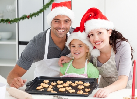 Happy woman with husband and daughter ith their biscuits ready  photo