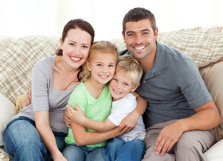 affections: Happy family sitting on the sofa