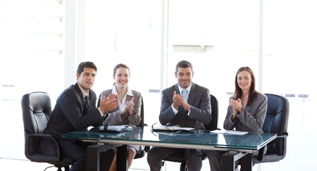 Cheerful businessteam applauding during a presentation Stock Photo - 10207182