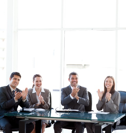 Cheerful businessteam applauding during a presentation photo