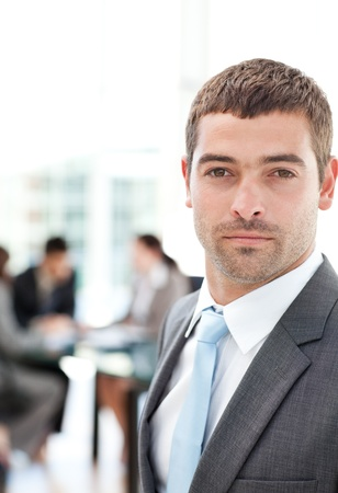 Charismatic businessman standing in the foreground photo