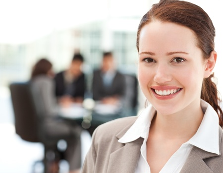 Cheerful businesswoman during a meeting with her team photo