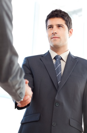 concluding: Below view of a serious businessman concluding a deal with a partner Stock Photo