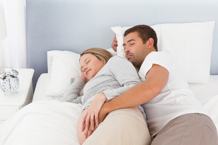 seven persons: Cute couple of future parents doing a nap Stock Photo