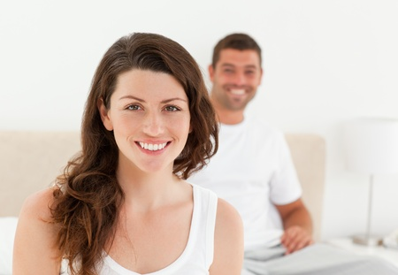 Lovely couple together in their bedroom in the morning Stock Photo - 10207719