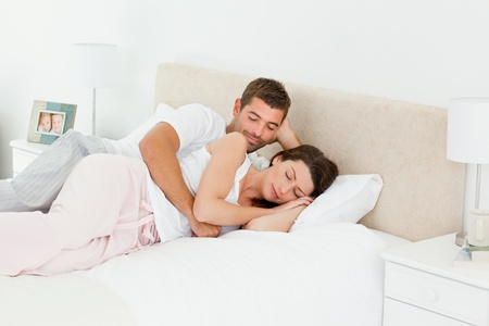 Attentive man looking at his girlfriend sleeping  photo