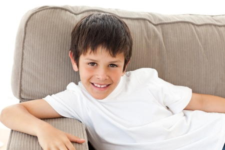 Portrait of an adorable child relaxing on the sofa photo