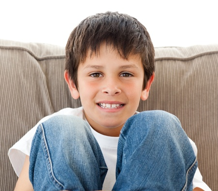 kids playing video games: Portrait of a happy child relaxing on the sofa