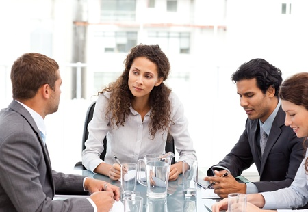Beautiful manager speaking with her team during a meeting photo