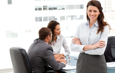Happy businesswoman with her team during a meeting photo