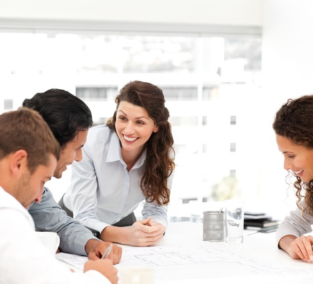 female architect: Happy female architect with her team during a meeting