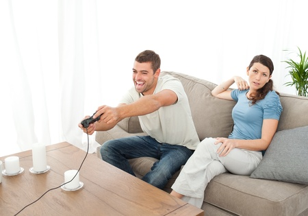 Desperate woman being bored while her boyfriend playing video game Stock Photo - 10218819