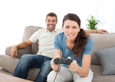Concentrated woman playing video game with her boyfriend Stock Photo - 10212912
