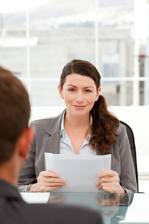 Charismatic businesswoman during an interview with a businessman Stock Photo - 10217587