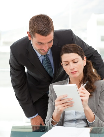 Handsome businessman speaking to a female colleague  photo