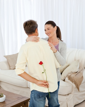 Lovely woman receiving a rose from her boyfriend Stock Photo - 10170508