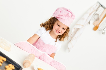 Portrait of a cute girl preparing cookies photo