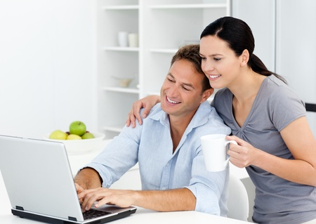 Affectionate woman looking at her boyfriend working on the laptop  photo