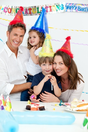 Portrait of cute children with their parents during a birthday party  photo