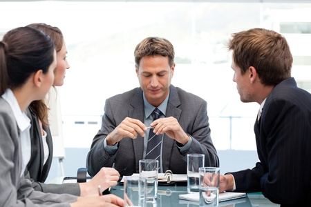 chairman: Serious manager at a table with his team during a meeting Stock Photo