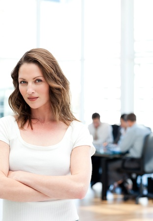 Confident woman standing at a meeting photo