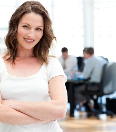 Happy businesswoman  posing in front of her team while working photo