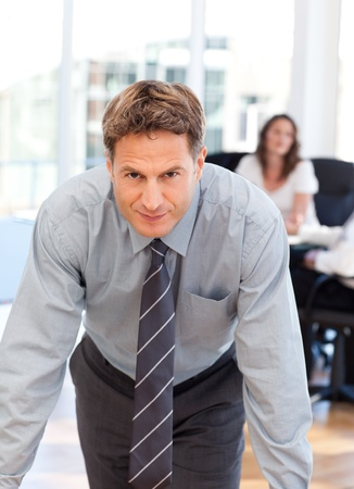 Confident man posing in front of his colleague during a meeting photo