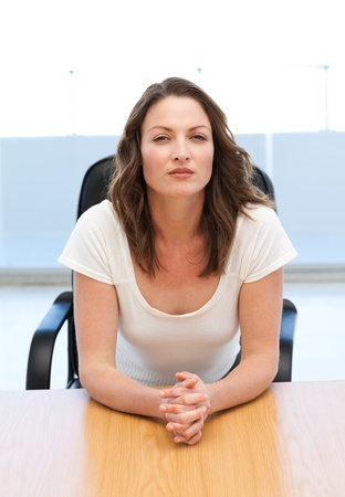 Thoughtful businesswoman sitting at a table photo
