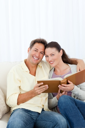 Portrait of a happy couple looking a photo album Stock Photo - 10172458
