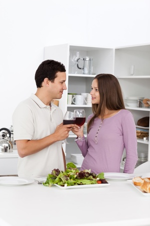 Young couple giving a toast during the lunch Stock Photo - 10215173