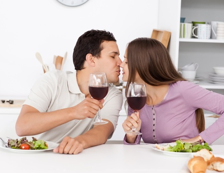 Cute couple giving a toast while having lunch Stock Photo - 10207110