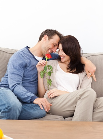 Enamored couple sitting together on the sofa Stock Photo - 10215232