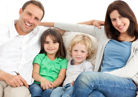 Portrait of a family on the sofa photo