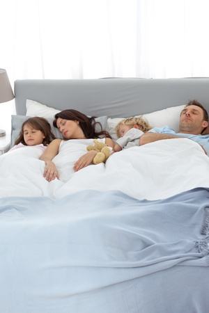 Peaceful family sleeping together photo