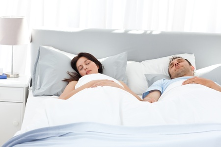 siesta: Lovely couple holding their hands while sleeping on their bed