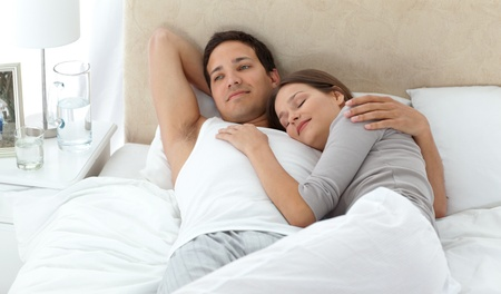 unbend: Man dreaming on his bed while relaxing with his girlfriend  Stock Photo