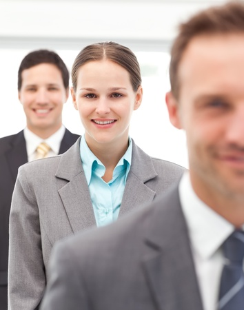 Happy businesswoman standing in a row with her two partners  photo
