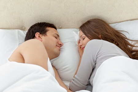 Serene couple sleeping together on their bed Stock Photo - 10198542