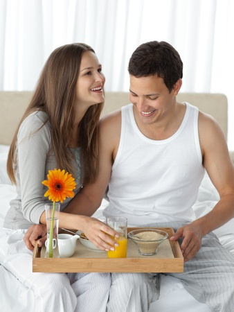 Adorable man holding the breakfast for his girlfriend photo