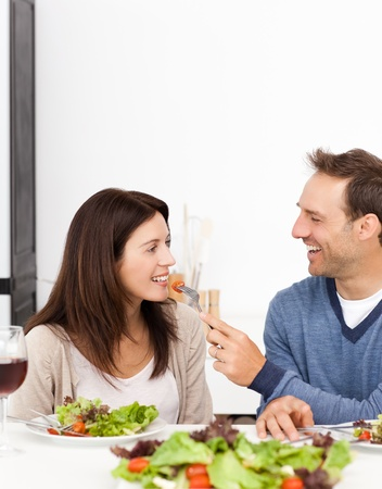 Man giving a tomato to his girlfriend while having lunch Stock Photo - 10217684