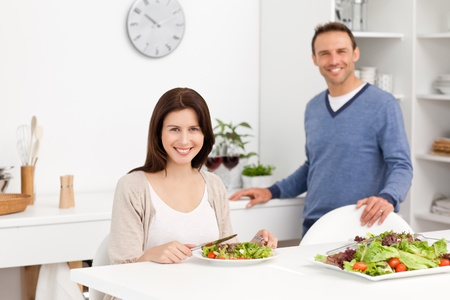 Happy man with his girlfriend in the kitchen photo