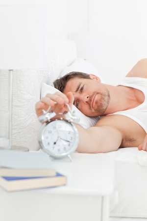 A unhappy man in his bed before waking up  Stock Photo - 10213313