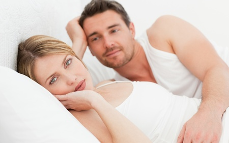 Lovely couple lying down together in their bed at home Stock Photo - 10214338