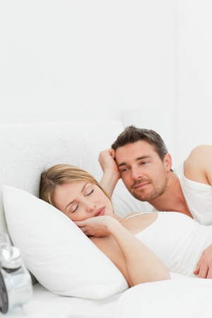 Boyfriend looking at his girlfriend who is  sleeping Stock Photo - 10207436