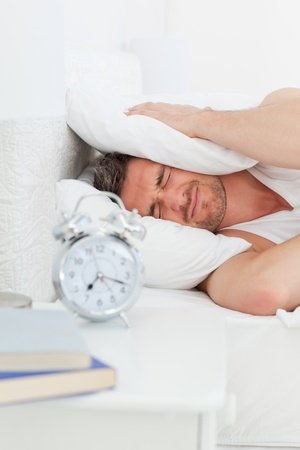 irritate: A irritate man in his bed before waking up