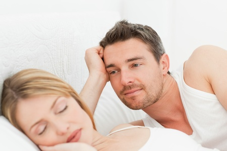 Boyfriend looking at his girlfriend who is  sleeping Stock Photo - 10215235