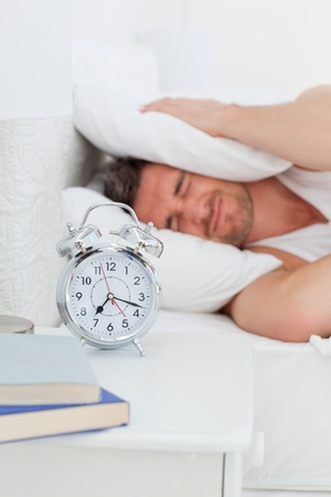 A irritate man in his bed before waking up Stock Photo - 10213590